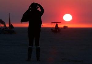 Burning Man: Libriel Padilla watches the sunrise at Burning Man