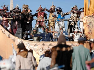 Burning Man: The Samurais dance at sunrise during the Burning Man 2012