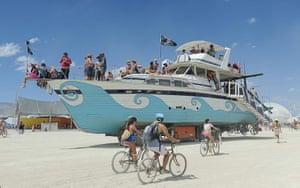 Burning Man: An old wooden yacht art car rolls through the playa at Burning Man