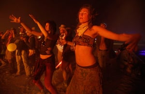 Burning Man: Sophie Keel and Emilyne Love dance around the burned remains of the Anubis