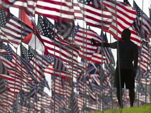 A man takes pictures walking among 3,000 US national flags at a memorial honouring the victims of the Sept. 11, 2001 terrorist attacks, set by students and staff on the campus lawn of Pepperdine University in Malibu, California.