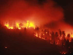 A wildfire burns out of control by highway 97C near Peachland, B.C. last night, 9 September.  Authorities have ordered the evacuation of about a thousand people from the path of a wildfire raging near Peachland, British Columbia.