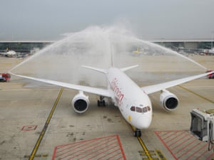 Wet welcome: fire engines spray water over an Ethiopian Airlines' Boeing 787 Dreamliner aircraft parked at Brussels airport for the first time on September 10. Ethiopian Airlines, the first African company to have bought this aircraft, purchased ten Dreamliners.