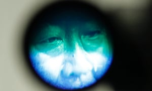 Japanese prime minister Yoshihiko Noda, leader of the ruling Democratic Party of Japan (DPJ), is seen through the viewfinder of a television camera during a joint news conference with presidential election candidates from other parties in Tokyo.