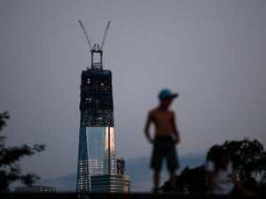 One World Trade Center stands tall on the skyline of New York's Lower Manhattan as a boy stands on a pier in Hoboken, New Jersey. New York will mark the 11th anniversary of the attack on the World Trade Center with ceremonies on September 11.