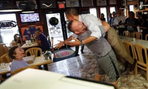 President Barack Obama looks slightly surprised as he is picked up and lifted off the ground by Scott Van Duzer, owner of Big Apple Pizza and Pasta Italian Restaurant, during an unannounced stop on his campaign trail in Florida last night.