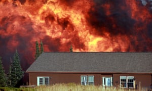 A wildfire burns near a home on Casper Mountain in  Wyoming, USA. Residences and campgrounds were evacuated as the uncontained wildfire spread across the southeast portion of the mountain.
