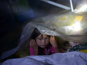 A young girl rests beside her bed at an emergency relief center in Yiliang, after two 5.6-magnitude quakes rocked southwestern Guizhou and Yunan provinces in China. Rescuers searching for survivors from earthquakes in China that killed at least 81 people were striving to reach the final isolated pockets after combing more than 90 percent of the remote area.