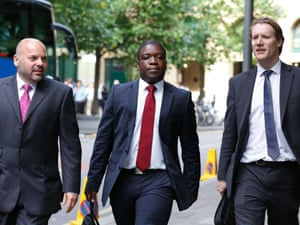 Former UBS trader Kweku Adoboli, centre, arrives at Southwark crown court accused of losing $2.3bn in a fraud at Swiss bank. Adoboli denies two counts of fraud and two of false accounting between 2008 and September 2011.