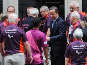 Prime Minister David Cameron greets some gamesmakers after inviting them to Downing Street in London before they take part in the athletes parade.