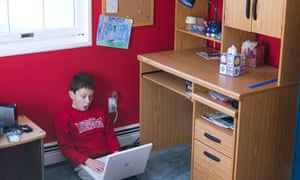 Boy surfing the internet on a laptop