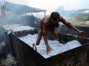 A Bangladeshi man works in a tannery in Dhaka