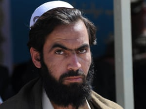 A newly-freed Afghan prisoner warily eyes the photographer during a ceremony handing over of the controversial Bagram prison to from U.S. to Afghan control.