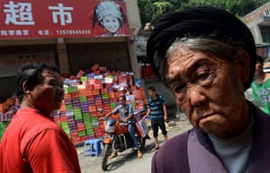 24 hours: Yiliang County, China: An elderly villager at a food distribution centre