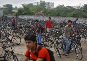 24 hours: Kota, India: Students leave on their bicycles after attending lectures