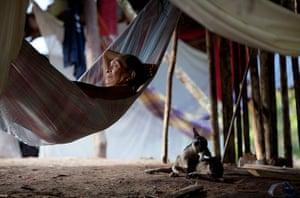 24 hours: Irotatheri, Venezuela: A Yanomami Indian elder rests in his hammock