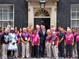David Cameron poses with Gamesmakers  on the steps of 10 Downing Street