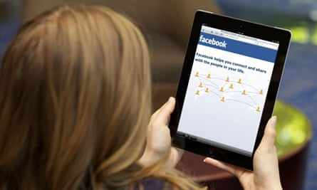 A young woman using Facebook on an Ipad