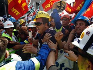 Workers  from the Alcoa aluminium plant in Sardinia attempt to march on the Ministry of Economic Development in Rome