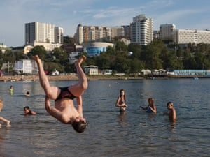 A boy is airborne as he dives into the sea in Vladivostok, Russia.