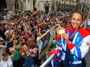 Heptathlete Jessica Ennis is cheered by huge crowds in front of the Royal Courts of Justice
