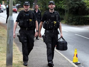 Police outside the home of Saad al-Hilli in Claygate, Surrey, after they evacuated an area around his home due to concerns about items found at the address.