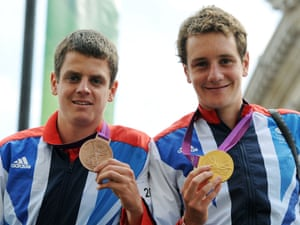 The Brownlee brothers, Jonathan (left) and Alistair, show off their triathlon medals.