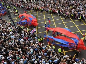 Don't block the box junction: looking down on the crowds lining the streets.