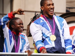 Nicola Adams and Anthony Joshua outside the Mansion house, as the parade moves off.