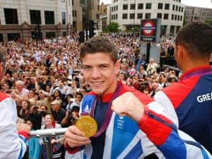 Boxer Luke Campbell holds his gold medal.