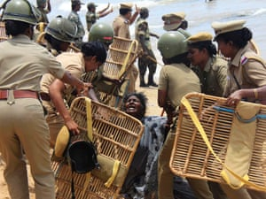 Police detain a demonstrator during a protest near a nuclear power project in Kudankulam in the southern Indian state of Tamil Nadu.