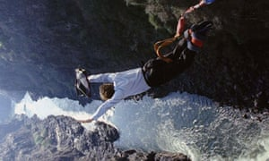 OPPENHEIMER DIVES OFF THE VICTORIA FALLS BRIDGE IN A BUNGEE JUMP STUNT