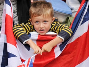 Is he thinking about the one after Rio? A young GBritain fan during the parade.