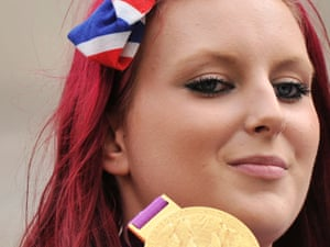 Jessica Jane Applegate shows off her gold medal and red hair with matching ribbon.