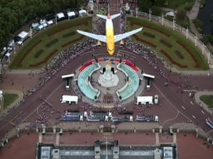 LONDON, ENGLAND - SEPTEMBER 10:  A golden British Airways airbus flies over the Queen Victoria Memorial outside Buckingham Palace