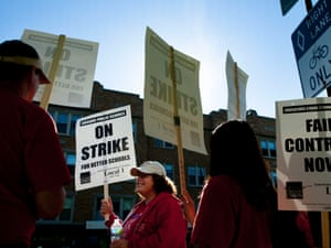 Public school teachers picket outside Amundsen High School on the first day of a strike by the Chicago Teachers Union, Monday, Sept. 10, 2012, in Chicago.