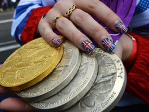 Paralympic swimmer Heather Frederiksen holds her gold and two silvers