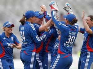 England's Anya Shrubsole, third from left, celebrates with team mates after taking a catch to dismiss West Indies' Deandra Dottin during the NatWest women's international T20 match at Old Trafford, Manchester.