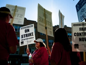 """Public school teachers picket outside Amundsen High School on the first day of a strike by the Chicago Teachers Union, September 10. The school is one of more than 140 schools in the Chicago Public Schools' """"Children First"""" contingency plan, which feeds and houses students for four hours during the strike."""