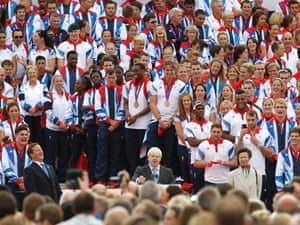 Boris Johnson addresses the crowd in front of the athletes