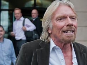 Virgin boss Sir Richard Branson leaves Britain's Houses of Parliament in London, on September 10, after giving evidence to the House of Commons Transport Committee over the governments decision to award the West Coast main line franchise to FirstGroup.