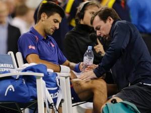 Novak Djokovic with trainer