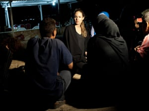 UNHCR Special envoy Angelina Jolie meets refugees on the Jordanian border minutes after 200 of them crossed from Syria on September 10, 2012. Photograph: Reuters/Jason Tanner/UNHCR Handout