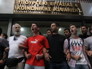 Members of the Communist Trade Union PAME block the entrance of the Labour Ministry obstructing the scheduled meeting of the Labour Minister Ioannis Vroutsis with representatives of the troika, in Athens, Greece, 11 September 2012.