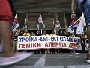 Communist-affiliated protesters block entrances to the Labour ministry in Athens , ahead of the sheduled visit there of the EU-IMF-ECB troika on September 11, 2012.