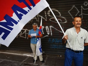 Protesters from the communist-affiliated trade union PAME block the entrance of the Labour Ministry, as inspectors from the European Union, the European Central Bank and the International Monetary Fund were expected to hold a meeting with Greece's labour minister in Athens September 11, 2012.