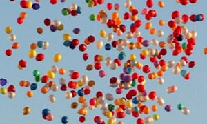 Thousands of balloons fly