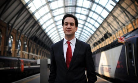 Ed Miliban poses for a photocall in Kings Cross station, London