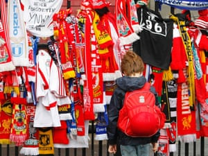 A young Liverpool fan looks at tributes to Hillsborough victims outside Anfield on 15 April 2009.