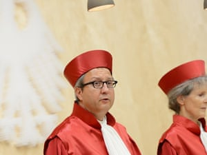 The President of the German Constitutional Court Andreas Vosskuhle (L) reads the verdict on Germany's ratification of the European Stability Mechanism (ESM) and fiscal compact on September 12, 2012 in Karlsruhe, Germany.